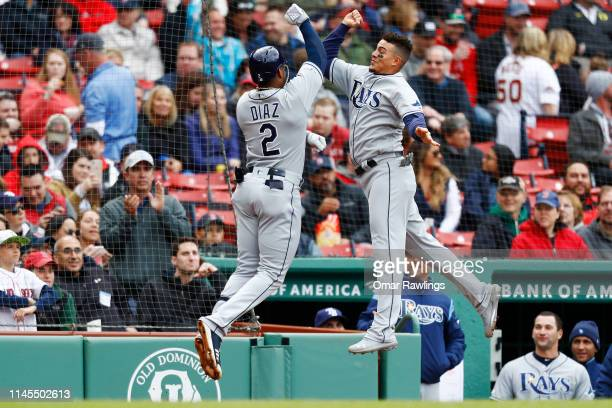 Yandy Diaz of the Tampa Bay Rays celebrates with Willy Adames of the Tampa Bay Rays after hitting a solo home run at the top of the first inning of...
