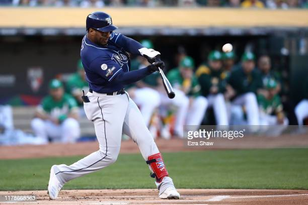 Yandy Diaz of the Tampa Bay Rays hits a solo home run off Sean Manaea of the Oakland Athletics in the first inning of the American League Wild Card...