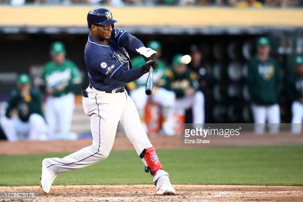 Yandy Diaz of the Tampa Bay Rays hits a solo home run off Sean Manaea of the Oakland Athletics in the third inning of the American League Wild Card...