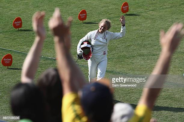 Yane Marcia Marques of Brazil waves to the crowd during the Fencing Modern Pentathlon on Day 14 of the Rio 2016 Olympic Games at the Deodoro Stadium...