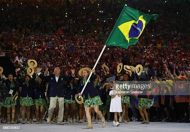 Yane Marques of Brazil carries the flag during the Opening Ceremony of the Rio 2016 Olympic Games at Maracana Stadium on August 5 2016 in Rio de...