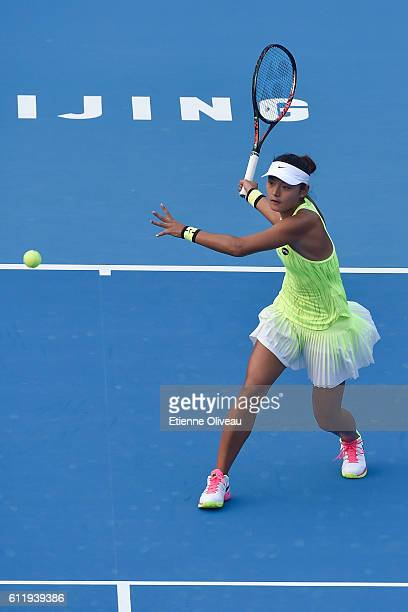Yanfan Wang of China plays a forehand in her match against Madison Brengle of the United States during the Women's singles first round on day two of...