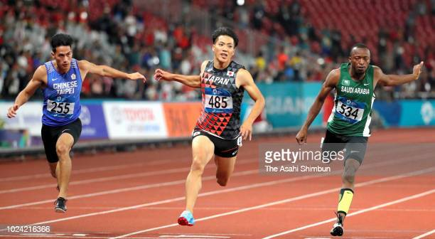 Yang Chunhan of Chinese Taipei Ryota Yamagata of Japan and Abdullah Akbar Mohammed of the United Arabe Emirates cross the finish line in the Men's...