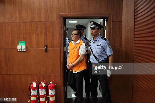 Yang Dacai a Chinese official branded 'Brother Watch' because of his expensive taste in timepieces walks into the courtroom in the Intermediate...