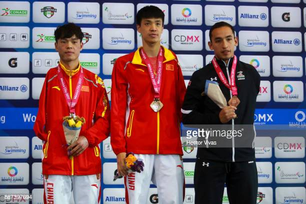 Yang Guanglong of China Xu Haijao of China and Luis Andrade of Mexico pose after the Men's 100m Butterfly S8 Final during day 5 of the Para Swimming...