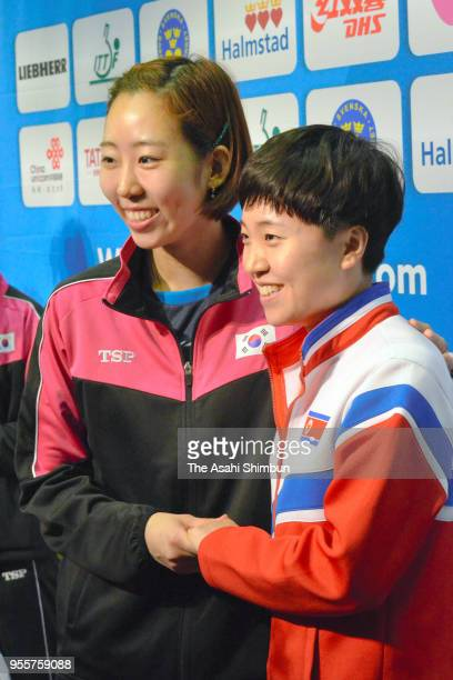 Yang Haeun of South Korea and KIM Song I of North Korean shake hands as they formed Team Corea on day five of the World Team Table Tennis...