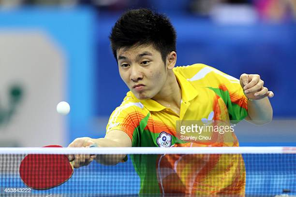 Yang Heng Wei of Chinese Taipei competes with Hugo Calderano of Brazil during Day Four of the Nanjing 2014 Summer Youth Olympic Games Boys Table...