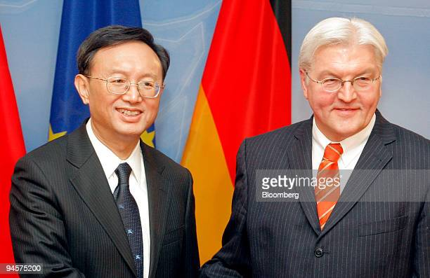 Yang Jiechi China's foreign minister left poses with FrankWalter Steinmeier Germany's foreign minister at the Foreign Ministry in Berlin Germany on...