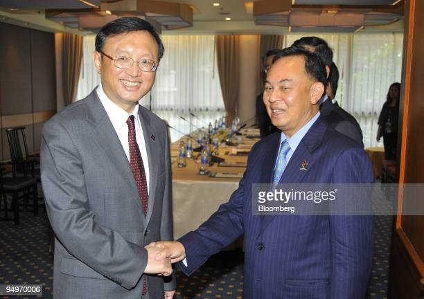 Yang Jiechi China's minister of foreign affairs left is welcomed by Kasit Piromya Thailand's minister of foreign affairs prior to bilateral talks at...