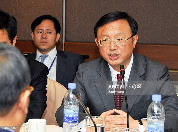 Yang Jiechi China's minister of foreign affairs right talks with Kasit Piromya Thailand's minister of foreign affairs left foreground during their...