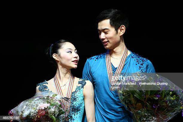 Yang Jin and Xiaoyu Yu of China look at each other on the podium after winning the Pairs Free Skating on Day 2 of the ISU World Junior Figure Skating...