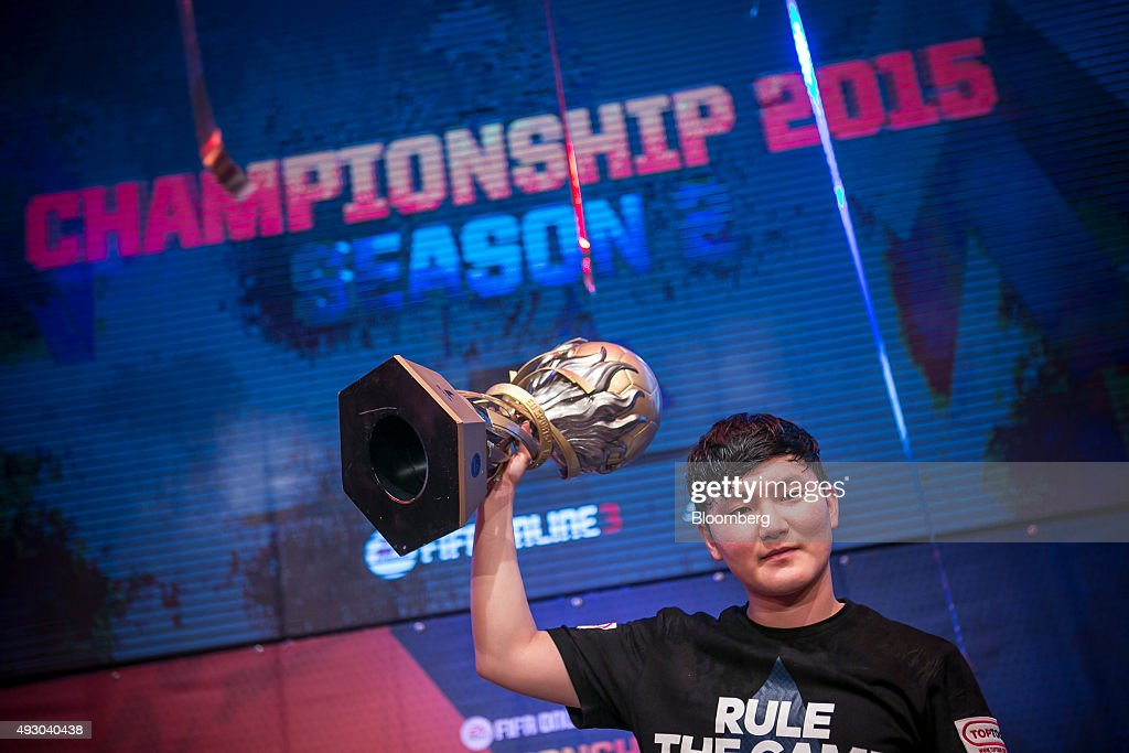 Yang Jin Hyeob, a professional video-game player, celebrates after winning the final round of the Electronic Arts Inc. (EA) Sports FIFA Online Championship at the Nexon Co. e-Sports Stadium in Seoul, South Korea, on Saturday, Oct. 17, 2015. Video game competitions, known as eSports, have been expanding as gamers seek to shift perceptions around their craft from a basement hobby to a serious money making industry. Photographer: Jean Chung/Bloomberg via Getty Images