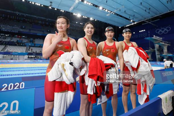 Yang Junxuan, Tang Muhan, Zhang Yufei and Li Bingjie of Team China celebrate after winning the Women's 4 x 200 m Freestyle Relay Final on day six of...