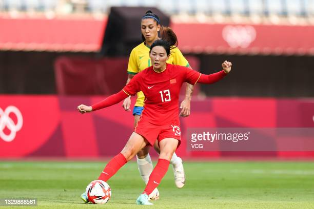Yang Lina of China passes the ball in the Women's First Round Group F match between China and Brazil during the Tokyo 2020 Olympic Games at Miyagi...