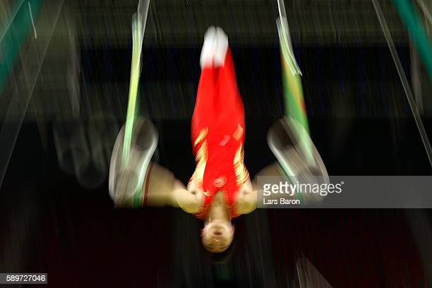 Yang Liu of China practices prior to the Men's ring Final on day 10 of the Rio 2016 Olympic Games at Rio Olympic Arena on August 15 2016 in Rio de...