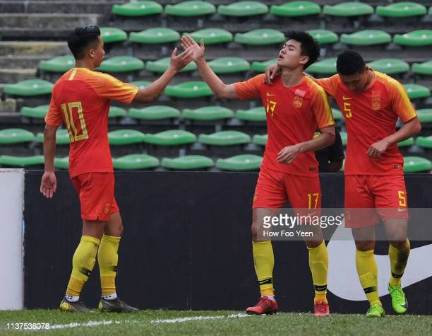 Yang Liyu Of China celebrates after scoring during the AFC U23 Championship qualifier between China and Laos at Shah Alam Stadium on March 22 2019 in...