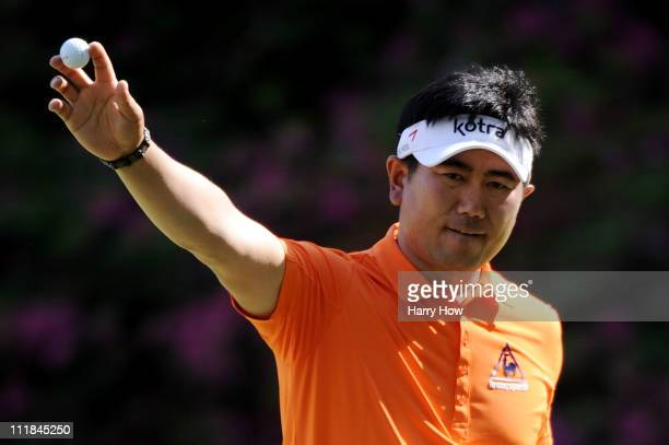 E Yang of South Korea celebrates an eagle putt on the 13th green during the first round of the 2011 Masters Tournament at Augusta National Golf Club...