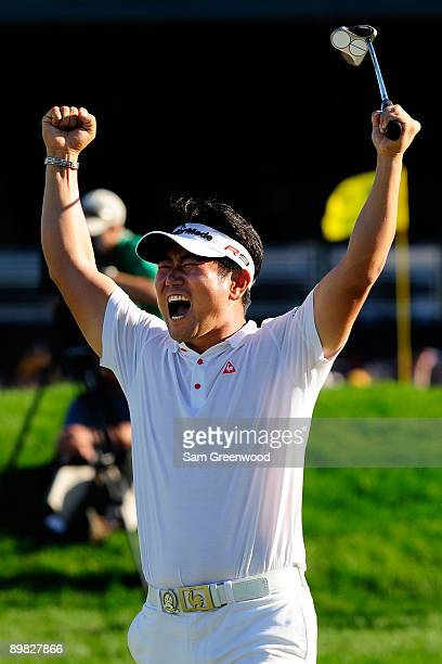 E Yang of South Korea celebrates his birdie putt on the 18th green during the final round of the 91st PGA Championship at Hazeltine National Golf...