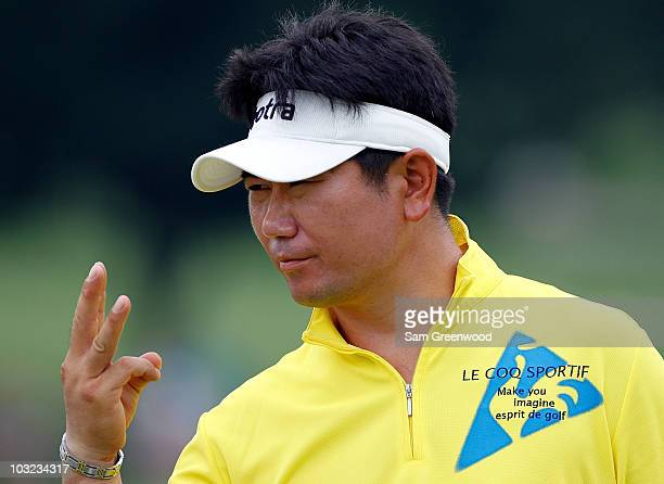 E Yang of South Korea displays three fingers during a practice round prior to the WGC Bridgestone Invitational on the South Course at Firestone...