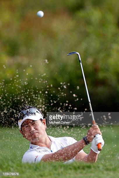 Yang of South Korea hits a shot out of the bunker on the third hole during the second round of the Deutsche Bank Championship at TPC Boston on...