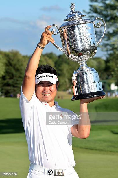 Yang of South Korea poses with the Wanamaker Trophy after his three-stroke victory at the 91st PGA Championship at Hazeltine National Golf Club on...