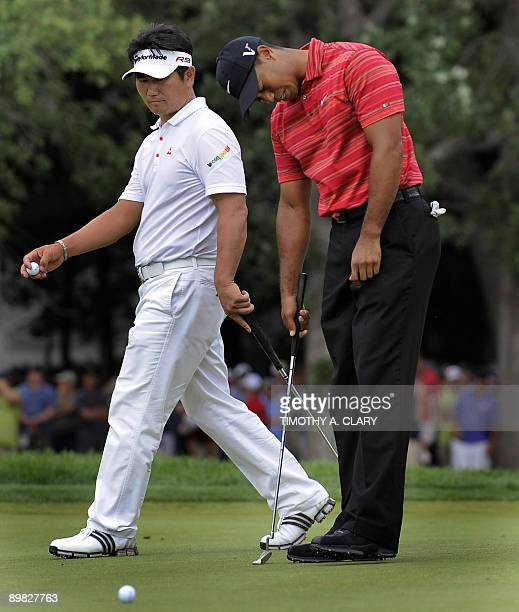 Yang of South Korea walks past as Tiger Woods of the US hangs his head after missing his putt on the 13th hole August 16 ,2009 at the 91st PGA...