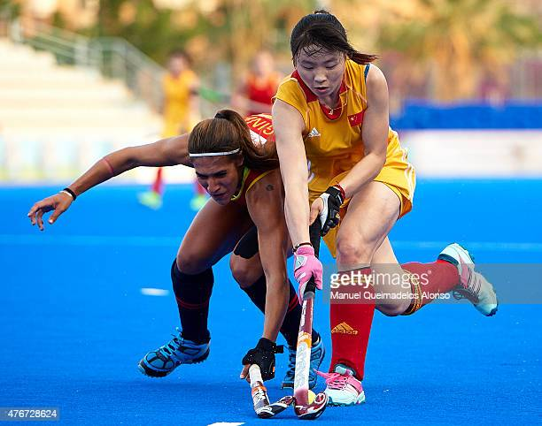 Yang Peng of China competes for the ball with Cristina Guinea of Spain during the match between China and Spain at Polideportivo Virgen del Carmen...