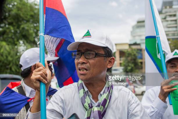 Yang Saing Koma seen holding a flag Grassroots Democratic Party is running for the July 2018 elections with Yang Saing Koma as candidate They held a...