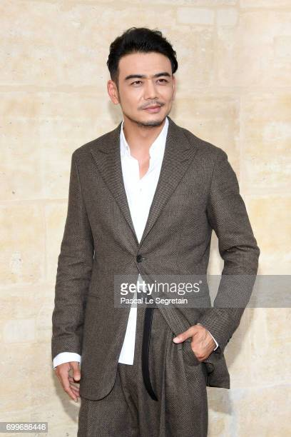 Yang Shuo attends the Louis Vuitton Menswear Spring/Summer 2018 show as part of Paris Fashion Week on June 22 2017 in Paris France