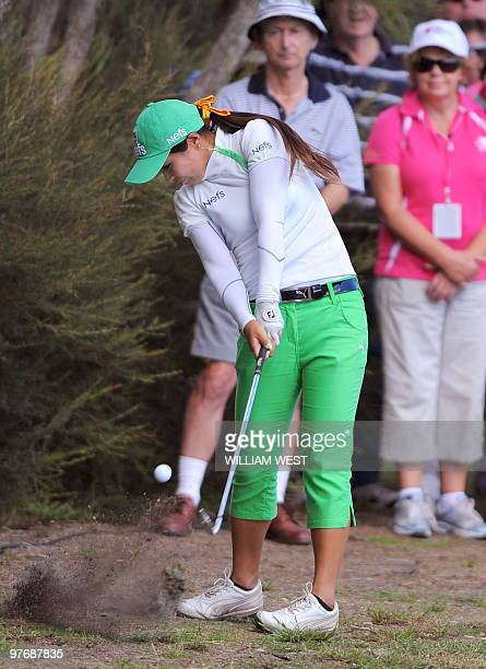 Yang SooJin of South Korea hits out of the rough is she fades to 30th position after being in contention at the start of the final round of women's...