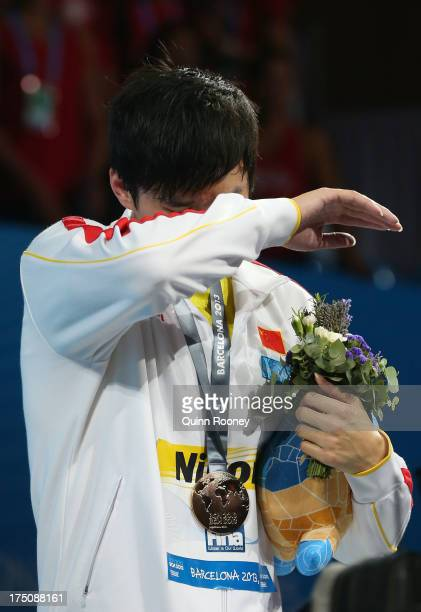 Yang Sun of China cries as he celebrates on the podium after winning the Swimming Men's 800m Freestyle Final on day twelve of the 15th FINA World...