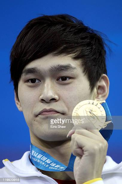 Yang Sun of China poses with his gold medal after the Men's 800m Freestyle Final during Day Twelve of the 14th FINA World Championships at the...
