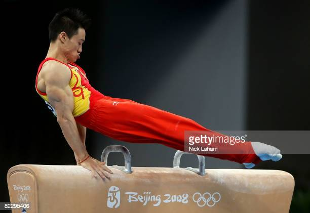 Yang Wei of China competes in the pommel horse during the men's individual all-around artistic gymnastics final at the National Indoor Stadium during...
