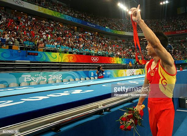 Yang Wei of China points to the crowd after winning the gold medal in the men's individual allaround final in the artistic gymnastics event at the...
