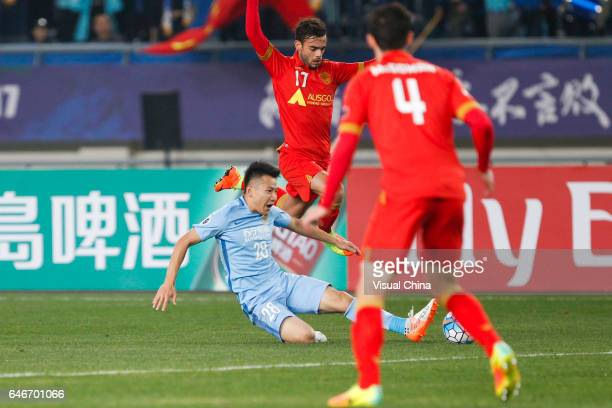 Yang Xiaotian of Jiangsu Suning and Nikola Mileusnic of Adelaide United compete for the ball during the AFC Champions League 2017 Group H match...