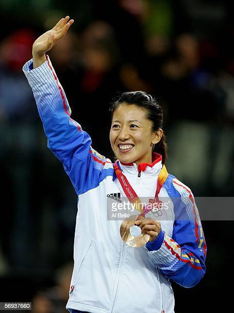 Yang Yang of China acknowledges the crowd after winning the bronze medal in the women's 1000 meter final in Short Track Speed Skating on Day 15 of...