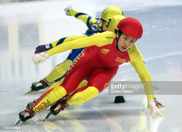 Yang Yang of China takes the lead 11 March 2000 and go on to win the women's 500m quarter final during the World Short Track Speed Skating...