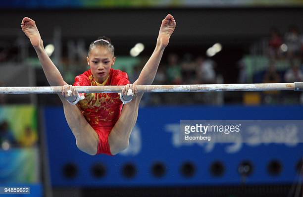 Yang Yilin of China performs on the uneven bars in the artistic gymnastics apparatus finals on day 10 of the 2008 Beijing Olympics in Beijing China...