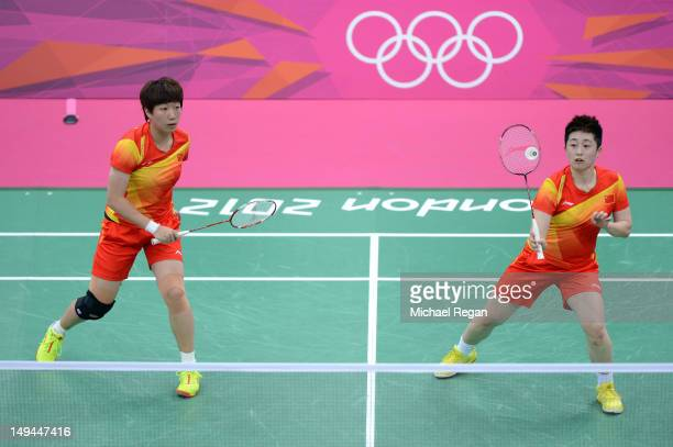 Yang Yu and Xiaoli Wang of China returns a shot against Michele Li and Alex Bruce of Canada during their Women's Doubles Badminton on Day 1 of the...