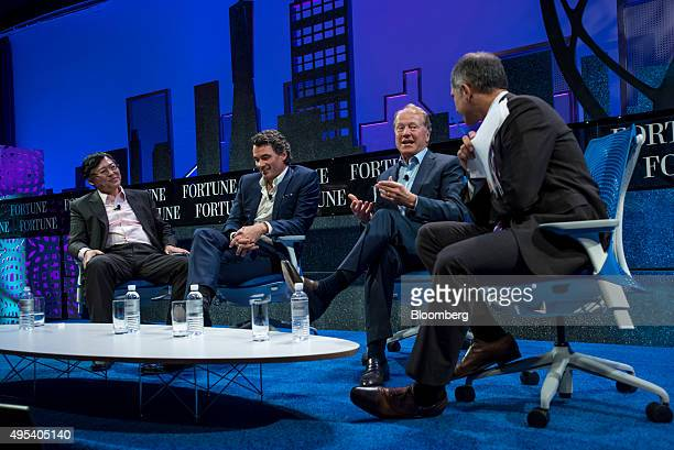 Yang Yuanqing chairman and chief executive officer of Lenovo Group Ltd left Gavin Patterson chief executive officer of BT Group Plc second left and...