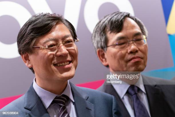 Yang Yuanqing chairman and chief executive officer of Lenovo Group Ltd left and Wong Wai Ming executive vice president and chief financial officer of...