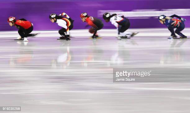 Yang Zhou of China, Bianca Walter of Germany, Maame Biney of the United States, Valerie Maltais of Canada compete during the Short Track Speed...