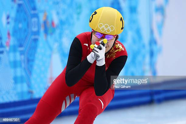 Yang Zhou of China celebrates winning the gold medal during the Ladies' 1500 m Final Short Track Speed Skating on day 8 of the Sochi 2014 Winter...