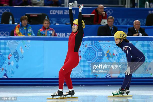 Yang Zhou of China celebrates winning the gold medal from Suk Hee Shim of South Korea during the Ladies' 1500 m Final Short Track Speed Skating on...