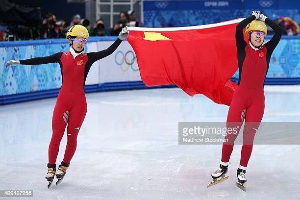 Yang Zhou of China celebrates winning the gold medal with Jianrou Li of China during the Ladies' 1500 m Final Short Track Speed Skating on day 8 of...