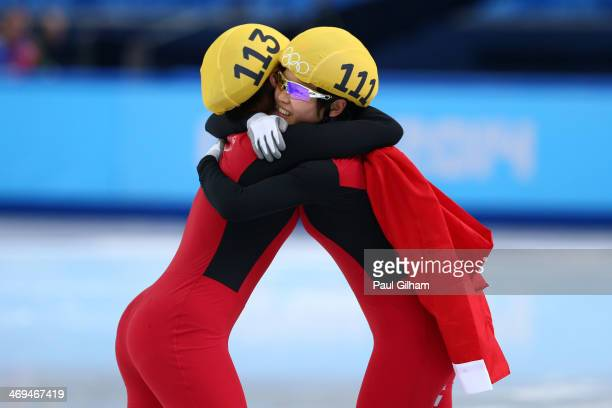 Yang Zhou of China is congratulated by Jianrou Li of China after winning the gold medal during the Ladies' 1500 m Final Short Track Speed Skating on...