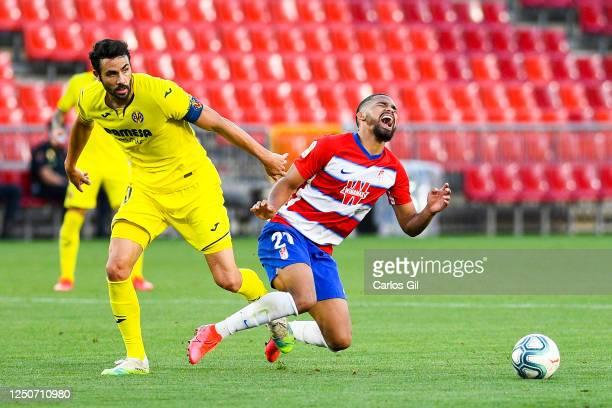 Yangel Herrer of Granada CF is brought down by Vicente Iborra of Villarreal CF during the Liga match between Granada CF and Villarreal CF at Nuevo...