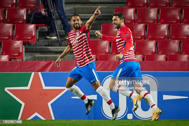 Yangel Herrera of Granada CF celebrates after scoring his team's first goal during the UEFA Europa League Round of 32 match between Granada CF and...