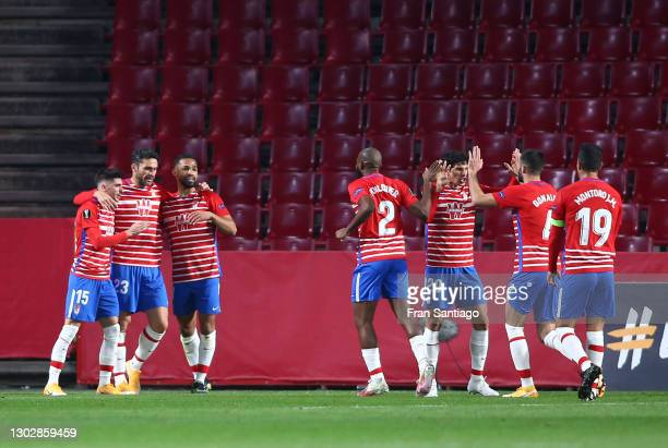 Yangel Herrera of Granada CF celebrates with teammates Carlos Neva and Jorge Molina after scoring their team's first goal during the UEFA Europa...