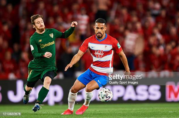 Yangel Herrera of Granada competes for the ball with Iker Muniain of Athletic Bilbao during the Copa del Rey Semi Final second leg match between...